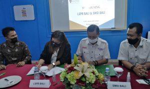 Penandatanganan kerjasama oleh Direktur Eksekutif LSPR Bali Gesille Sedra Buot Zambrano dan Ketua SMSI Bali Emanuel Dewata Oja, pada Jumat (03/09/2021). Foto: Dok.SMSI Bali